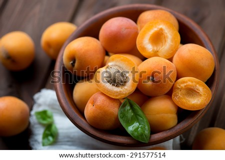 Ripe apricots in a ceramic bowl, close-up, selective focus - stock photo