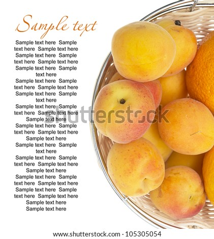 ripe apricots in bowl isolated on white background with sample text - stock photo