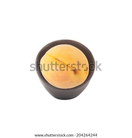 Ripe Apricots in ceramic cup isolated over white background - stock photo
