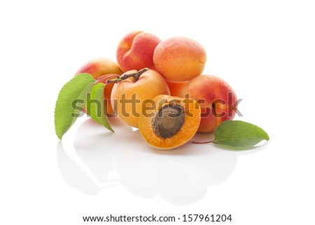 Ripe apricots isolated on white background. Healthy summer fruit eating.  - stock photo