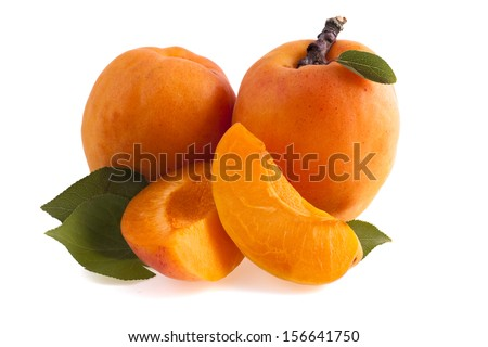 Ripe apricots with green leaf isolated on white background - stock photo