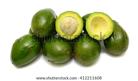Ripe Avocado fruits with half isolated on white background