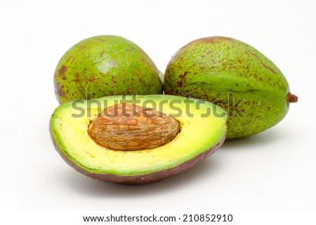 Ripe avocado isolated on white. - stock photo