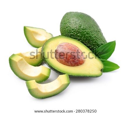 Ripe avocado with leaves close up on white - stock photo