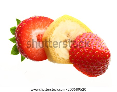 Ripe banana and berry strawberry isolated on white background - stock photo