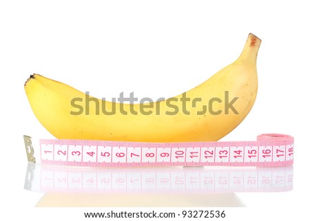 Ripe banana and measuring tape isolated on white - stock photo