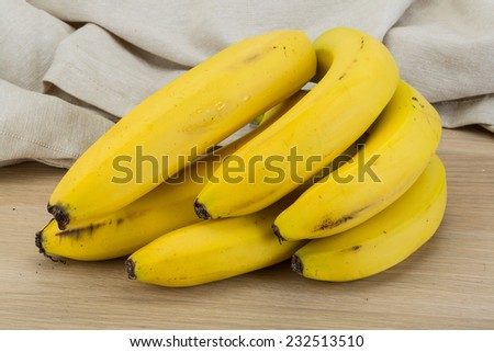 Ripe Banana branch on the wooden background