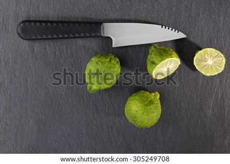 Ripe bergamot fruit on black background, top view. Culinary cooking ingredient, tropical fruit bergamot orange - stock photo