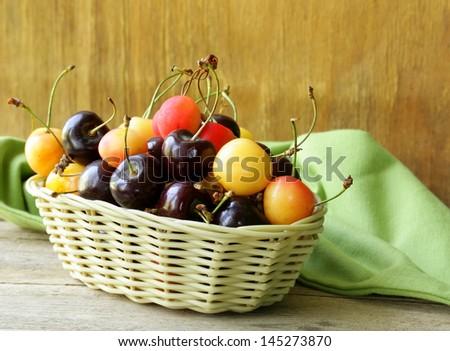 ripe berries cherries in a wicker basket - stock photo