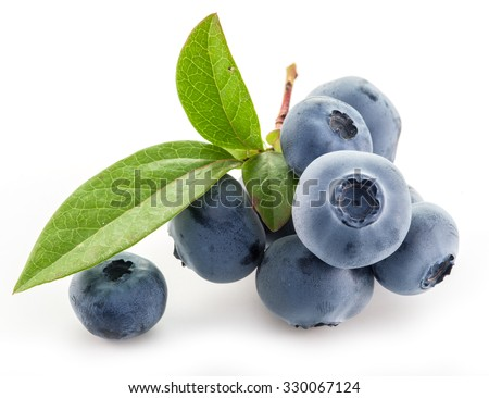 Ripe berries in the wooden bowl over green grass. - stock photo