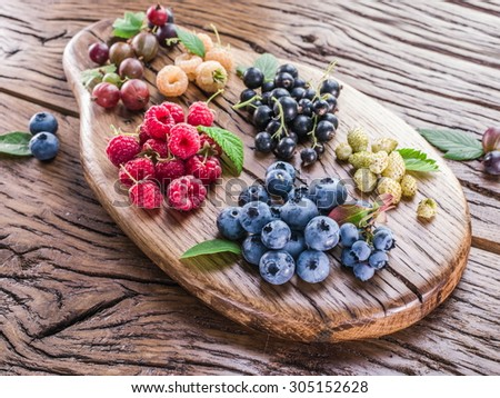 Ripe berries on the old wooden plank.