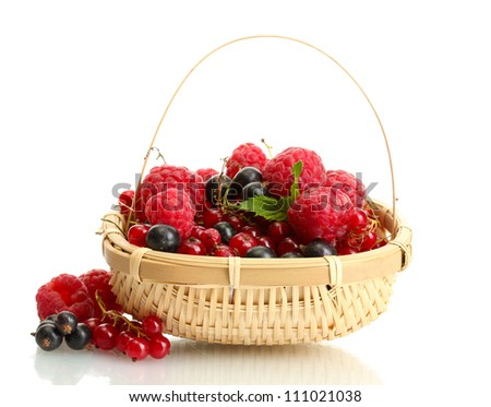 ripe berries with mint in basket isolated on white - stock photo