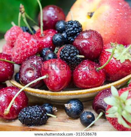Ripe berry . Raspberry , strawberry , blackberry , mulberry , cherry, sweet cherry in drops of water - stock photo