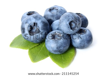 Ripe bilberries with green leaves on white background - stock photo