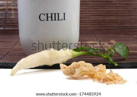 Ripe Blondie chili on a bamboo mat - stock photo