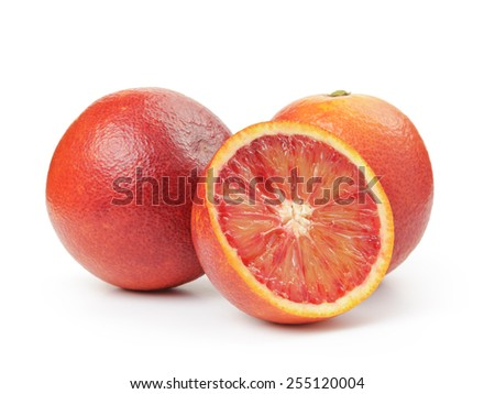 ripe blood red oranges with half isolated on white - stock photo