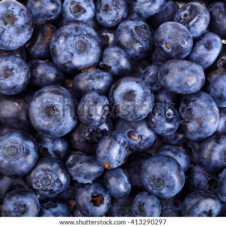 ripe blueberries in a container as a background