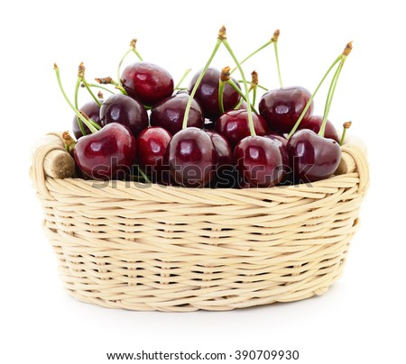 Ripe cherries in basket on a white background.