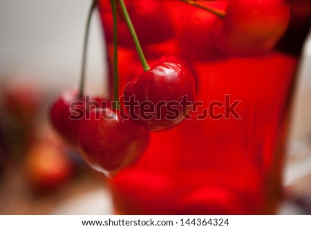 ripe cherries lie on a wooden table. juice, cocktail cherries - stock photo