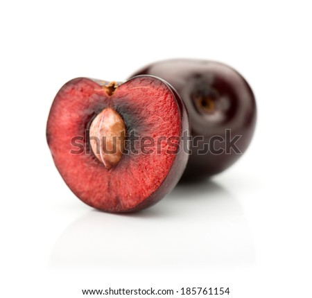 Ripe cherries on a white isolated background.