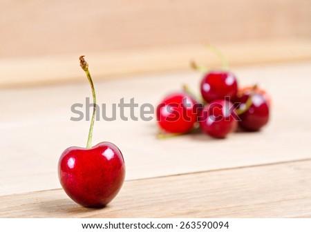 ripe cherries on wood background - stock photo