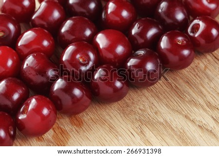 ripe cherries on wood table organic food background - stock photo