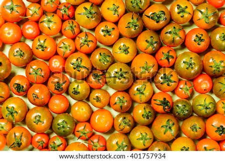 Ripe cherry tomatoes, cabbage and zucchini with cucumber, textured leaves on the wooden table. view from above with copy space. / Ripe Cherry Tomatoes - stock photo