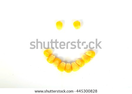 Ripe corn . A few grains of canned corn on a white background. Sweet whole kernel corn, selective focus - stock photo