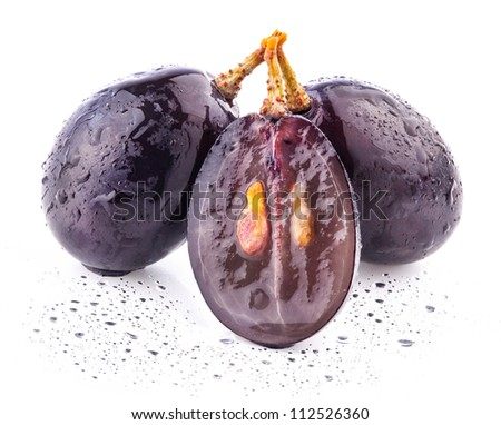 Ripe dark grapes with leaves, with clipping path Isolated on white background - stock photo
