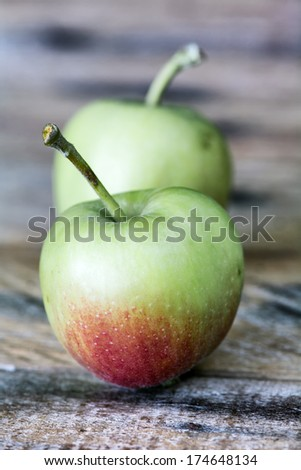 Ripe delicious apples on wooden table  - stock photo