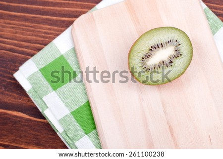 ripe delicious sliced kiwi on a board with  napkin - stock photo