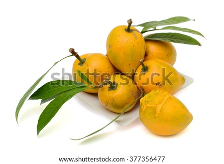 Ripe Egg fruits with leaves isolated on white background