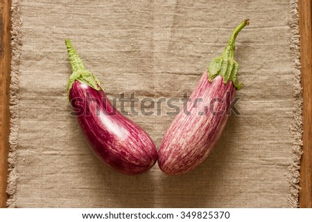 ripe eggplant on a wooden background, tasty food - stock photo