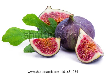 Ripe fig with water drops and green leaf isolated on white - stock photo