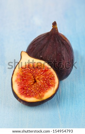 Ripe figs on blue wooden table close-up