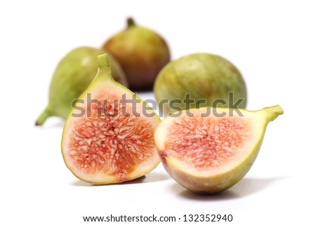 Ripe figs on white - stock photo