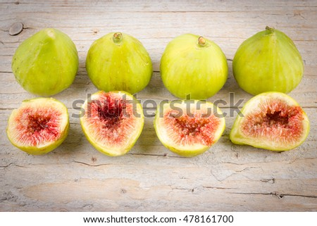 Ripe figs on wooden background