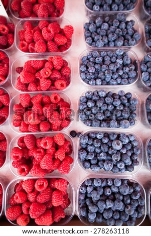 Ripe, fresh and delicious raspberries and blueberries - stock photo