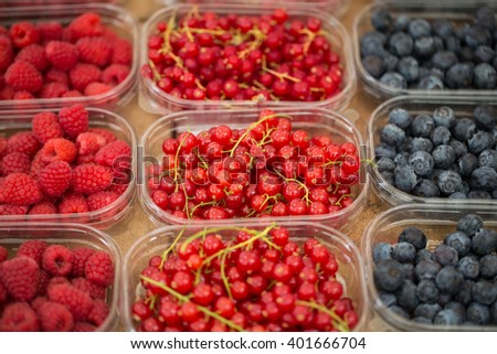 Ripe, fresh and delicious red currants, raspberries and blueberries - stock photo