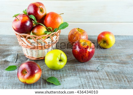 Ripe fresh apples in the wicker basket. Fresh apple fruits. Healthy vegetarian food. Healthy eating concept.  - stock photo