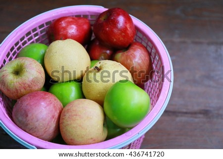 Ripe fresh apples in the wicker basket. Fresh fruits. Fresh apples. Healthy food. Healthy eating. Vegetarian food. Healthy eating concept. - stock photo