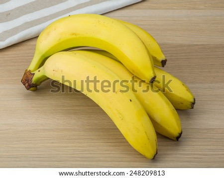 Ripe fresh Banana on the wooden background