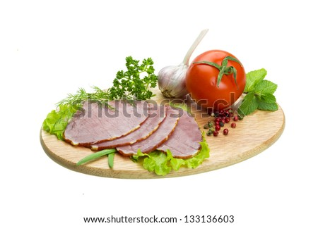 Ripe fresh ham with vegetables