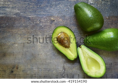 Ripe fresh organic avocado on a rustic wooden background.Top view. - stock photo