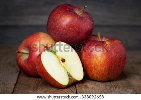 Ripe fresh red apples on wooden rustic table close up - stock photo