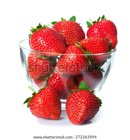Ripe fresh strawberries on plate close up on white background - stock photo