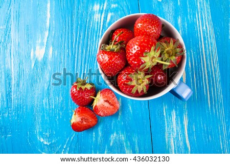 Ripe fresh strawberry on a wood desk. Nature background - stock photo
