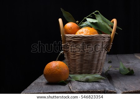 Ripe fresh tangerines on a old wooden table