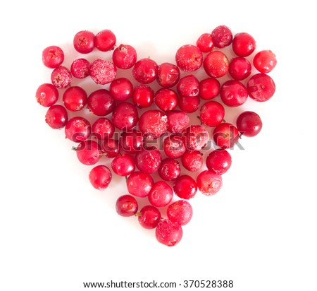 Ripe frozen cranberries in the form heart surface top view isolated on white background. Valentines day - stock photo