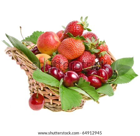 ripe fruit and berry in the basket isolated on white - stock photo